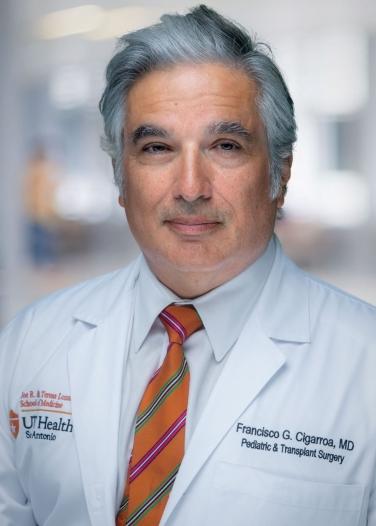 photo of Dr. Francisco Cigarroa in white coat orange stripped tie